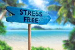 Stress free sign board arrow. Stress free board arrow on beach with sunshine background royalty free stock images