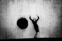 Stress. Girl near the wall. A girl and a black hole Royalty Free Stock Photo