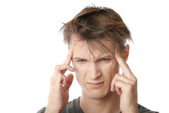 Stress and headache. Young man feeling emotional stress and headache Stock Image