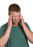 Stress headache. Man with stress headache tension isolated on white Royalty Free Stock Photo