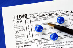 Stress and headache in filing the tax return Stock Photo