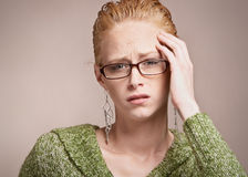 Stress headache. Unhappy woman with stress headache Stock Images
