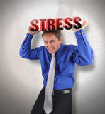 Stress Man Under Pressure. A business man is holding up the text stress and it is heavy for a metaphor concept for debt or money problems Stock Image