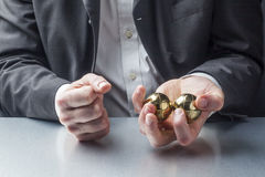 Stress management with hands massage at work. Male manager with metallic anti-stress balls in his hands on the workplace Stock Image