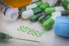 Stress, medicines and syringes as concept Stock Photography
