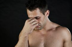 Stress and pain. Young man holding head. Pain and despair Stock Photos