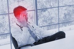 Stress people health problem concept : pain face headache person. In office ,selective focus Stock Photos