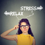 Stress or relax. Confused skeptical woman thinking looking up Stock Photo