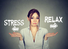 Stress or relax. Confused woman shrugging shoulders doesn`t know. Stress or relax. Portrait confused skeptical young woman shrugging shoulders doesn`t know Royalty Free Stock Photos