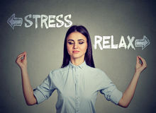 Stress or relax. Young woman meditating. Isolated on gray wall background. Human face expressions, emotions, feelings stock images