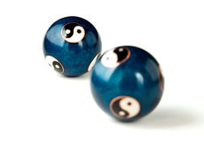 Stress relief balls. Two blue stress relief balls with ying and yang signs Stock Photography