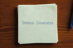 Stress Sickness written on a note Royalty Free Stock Photography