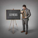 Stress text on blackboard with businessman Stock Photography