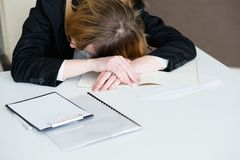 Stress tiredness overworking exhausted woman desk. Stress tiredness overworking. exhausted business woman laid her head on the office desk royalty free stock images