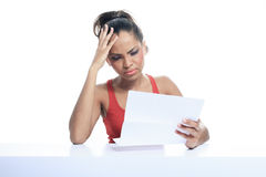 Stress woman paying bills, isolated on white Royalty Free Stock Photo