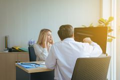 Stress woman talking to doctor psychiatrist in hospital,Discuss issue and find solutions to mental health problems. Stress women talking to doctor psychiatrist stock image