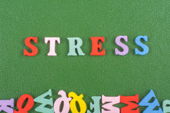 STRESS word on green background composed from colorful abc alphabet block wooden letters, copy space for ad text Stock Photo