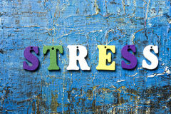 STRESS word written on abc letter at abstract grunge background. STRESS word written on abc letter at abstract grunge background Stock Image