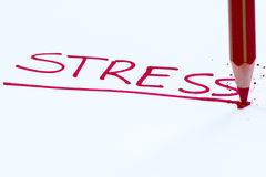 Stress. The word stress written in a paper with a pencil Stock Photo