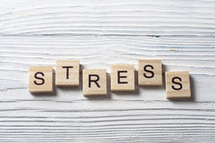 STRESS word written on wood abc cubes at wooden background Royalty Free Stock Photography