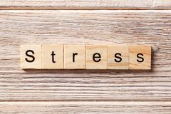 Stress word written on wood block. Stress text on table, concept.  Stock Photo