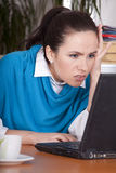 Stress by the work. Frustrated secretary by the office work at laptop computer Stock Photo