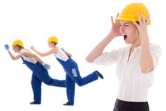 Stress at work -business woman architect in yellow builder helme Stock Photography