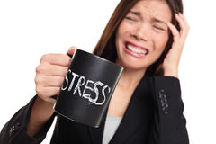 Stress at work concept - business woman stressed. Stress at work concept. Business woman stressed being to busy. Businesswoman in suit holding head drinking Royalty Free Stock Photography