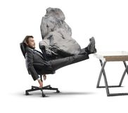 Stress at work. Concept of stress at work with businessman crashed Royalty Free Stock Photography