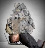 Stress at work. Concept of Stress at work with rocks above the head stock photo