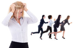 Stress at work - stressed business woman and her running colleag. Stress at work - stressed business women and her running colleagues isolated on white Stock Photos