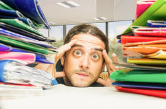 Stressed man headache at work office Stock Photos