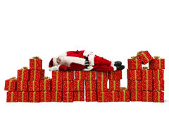 Stress for xmas gifts. Santa Claus sleeping over Christmas gift packs Royalty Free Stock Photography