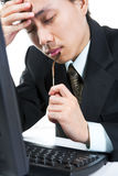 Stress young businessman. Side view of a stress young businessman in his office Stock Image
