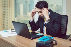 Stress young businessman at workplace stock image