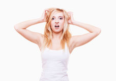 Stress. Young woman frustrated pulling her hair on white Stock Photography