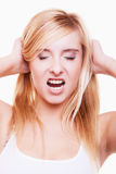 Stress. Young woman frustrated pulling her hair on white Stock Image