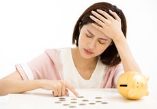 Stress young woman with piggy bank Stock Image
