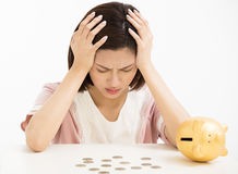 Stress young woman with piggy bank Royalty Free Stock Image