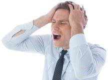 Stressad affärsman med händer på huvudet Royaltyfria Bilder