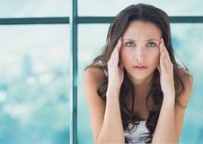 Stressad bekymrad kvinna mot fönster Royaltyfria Foton