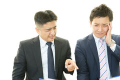 Stressade asiatiska affärsmän Arkivbild
