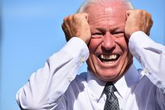 Stressed Adult Senior Business Executive Wearing Tie. A retired senior adult male stock photos