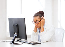 Stressed african woman with computer Stock Photo