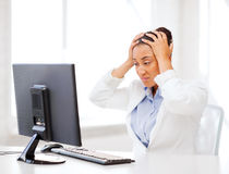 Stressed african woman with computer Royalty Free Stock Photos