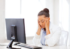 Stressed african woman with computer Royalty Free Stock Photo