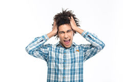 Stressed afro american man with curly hair screaming Royalty Free Stock Images