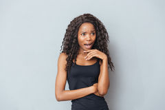 Stressed afro american woman screaming. On gray background Stock Photos