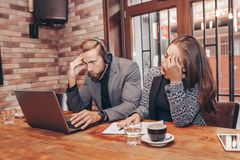 Stressed angry business man and woman with laptop royalty free stock photo