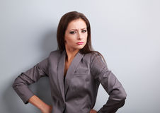 Stressed angry business woman in suit looking Stock Photo